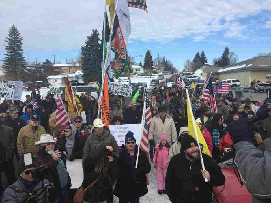 Protesters in Burns, Ore., march toward the home of Dwight Hammond Jr., a local rancher convicted of arson on federal land. The Jan. 2 protest was peaceful, but ended with a group of militiamen occupying the Malheur National Wildlife Refuge.