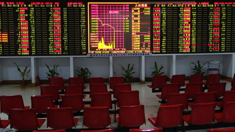 A trading hall sits empty in a securities firm in Haikou, China, Monday. Trading on the Shanghai and Shenzhen stock markets was ended before 2 p.m. Monday after shares tumbled 7 percent. (Zhao Yingquan/Xinhua /Landov)