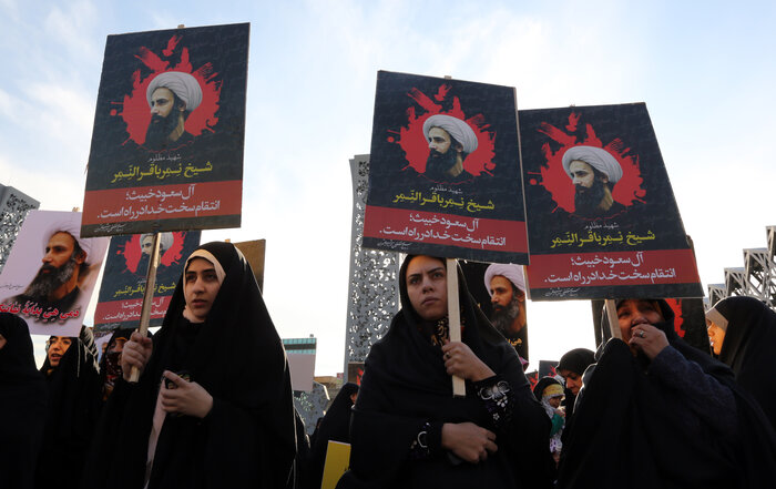 Iranian women in the capital Tehran demonstrate against the execution of a prominent Shiite Muslim cleric Nimr al-Nimr, as seen on the signs. He was among 47 people beheaded by Saudi authorities on Saturday, a move that escalated tensions between the two countries. (Atta Kenare/AFP/Getty Images)