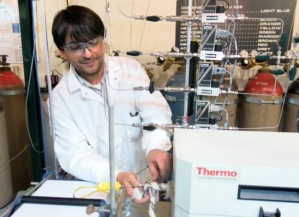 Anthony Richard, a chemical engineering student at the University of Wyoming, experiments with converting CO2 into methanol.