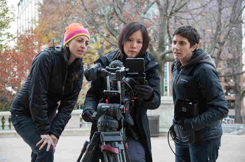 Filmmakers Laura Ricciardi (left) and Moira Demos (right) work alongside Iris Ng on the set of Making a Murderer.
