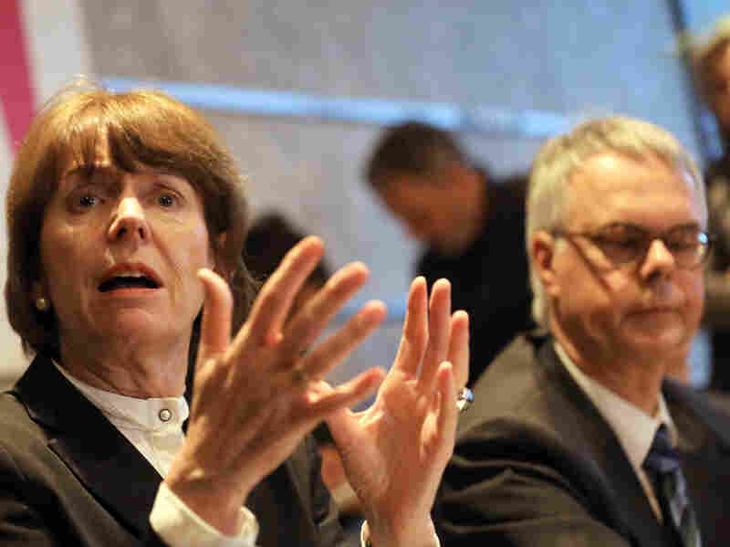 """Cologne Mayor Henriette Reker and police chief Wolfgang Albers speak to the press after a meeting to discuss the New Year's Eve attacks. Albers has described the gangs as looking """"Arab or North African,"""" but Reker warned against drawing hasty conclusions about their identity."""