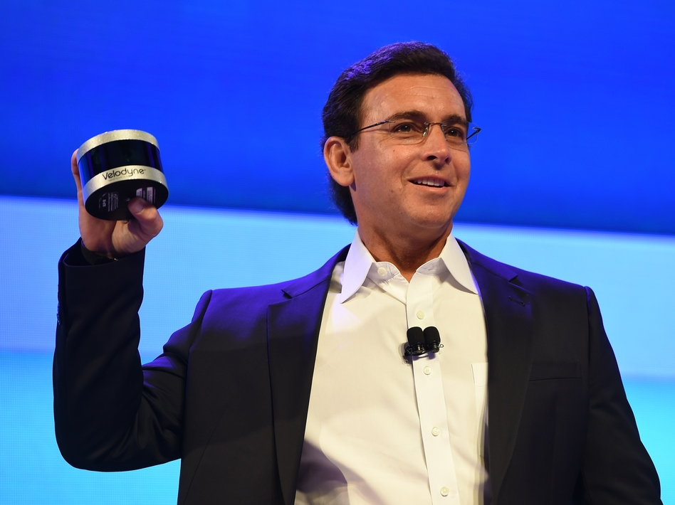 Ford CEO Mark Fields shows off the new Velodyne Puck sensor at a press conference Tuesday in Las Vegas, ahead of the CES 2016 Consumer Electronics Show. Veoldyne Lidar devices help autonomous cars scan the road ahead and plot a safe course. (Robyn Beck/AFP/Getty Images)