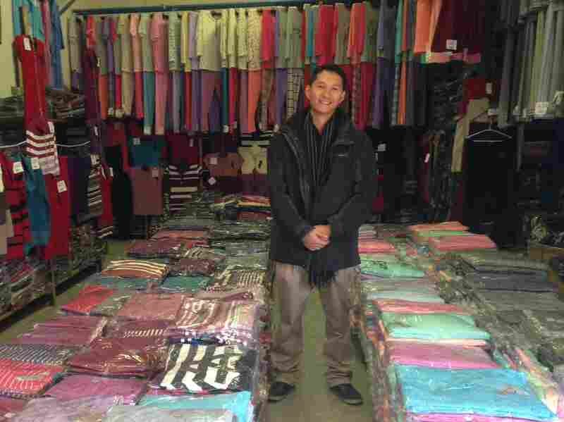 "Nguyen Kien Trung, 32, stands inside his family's clothing warehouse in Bratislava. ""It's a declining business, so we have to think out our future,"" he says. ""I think I and other young Vietnamese have a good chance at finding work at a Slovak company. We speak the language. We know the culture."""