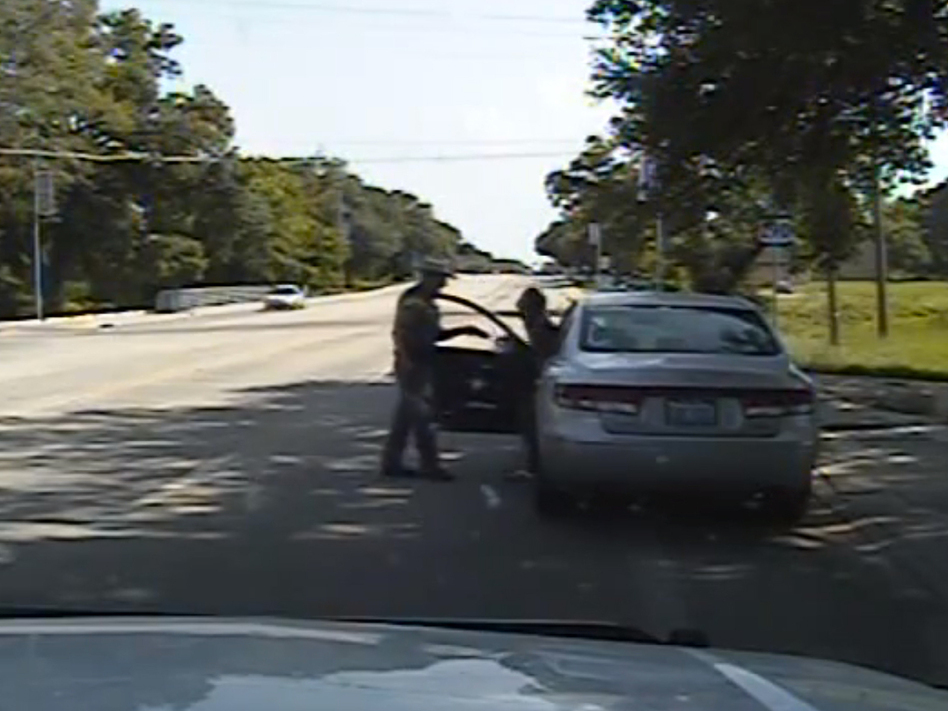 In this frame from the dashcam video, Texas State Trooper Brian Encinia confronts Sandra Bland after a minor traffic infraction. She was later arrested and was found hanged in her jail cell days later. (Uncredited/AP)