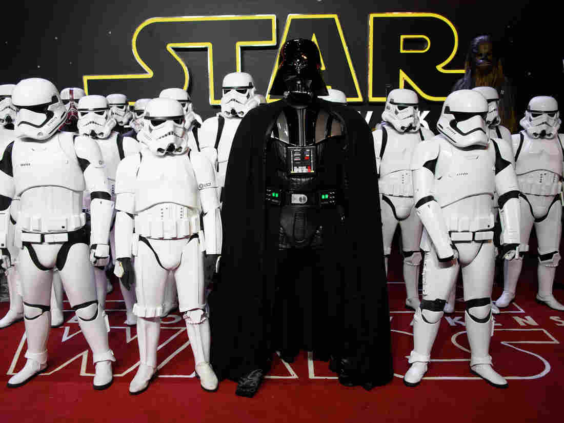 Actors dressed as Stormtroopers and Darth Vader pose at the European premiere of Star Wars: The Force Awakens in London on Dec. 16.