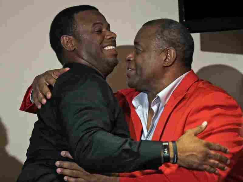 Ken Griffey Jr. (left) hugs his father, Ken Griffey, in 2014, after Griffey Jr. joined him in the Cincinnati Reds Hall of Fame. Now Griffey Jr. has been elected to the Baseball Hall of Fame.