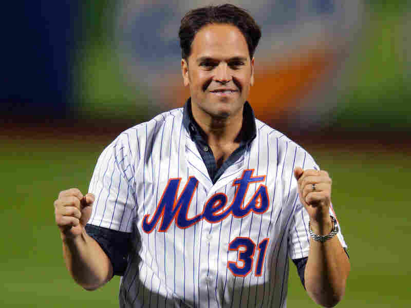 Former New York Met Mike Piazza celebrates last year after throwing out the first pitch in Game 3 of the World Series. He's been elected to the Baseball Hall of Fame.