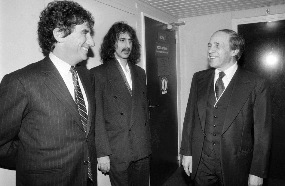 French conductor and composer Pierre Boulez (right), seen here in 1984 with musician Frank Zappa (center) and French Minister of Culture Jack Lang, has died at age 90. (Joel Robine/AFP/Getty Images)