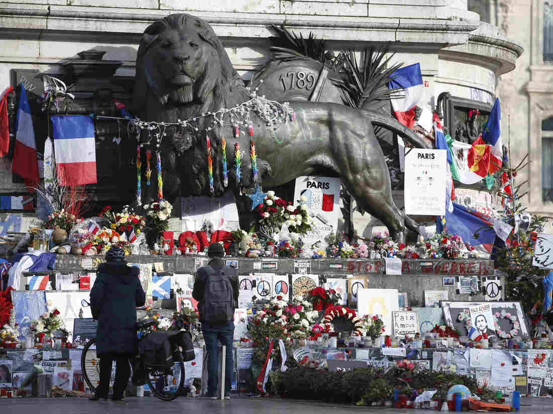 Flowers and messages at Paris' Place de la Republique commemorate the victims of last year's January and November shooting attacks.