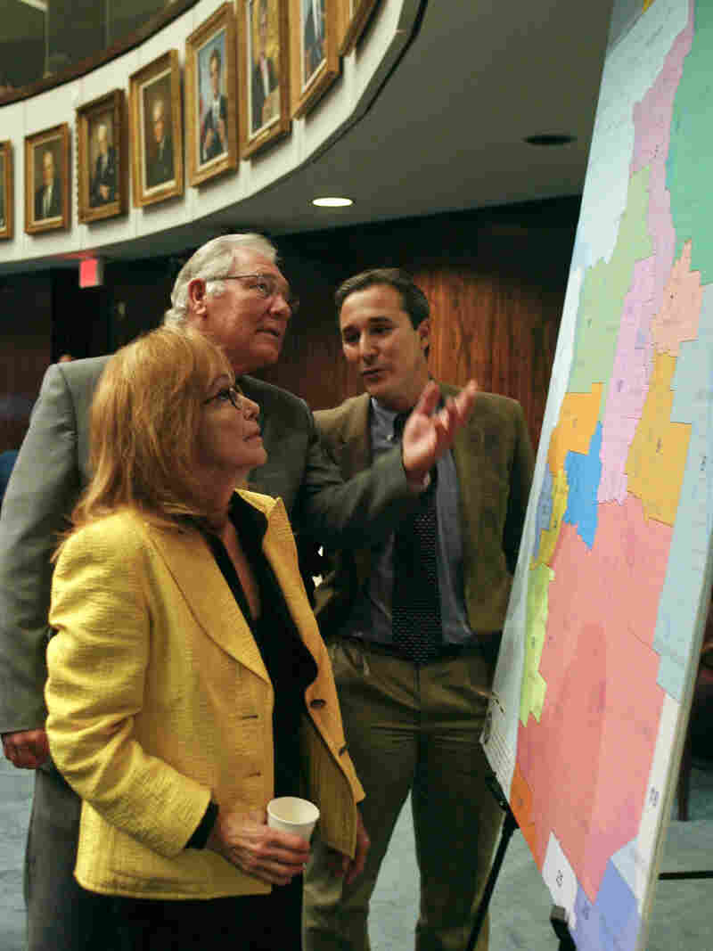 Florida state Sens. (from left) Eleanor Sobel, Greg Evers and Rene Garcia discuss a congressional redistricting map on the floor of the Senate in 2014.
