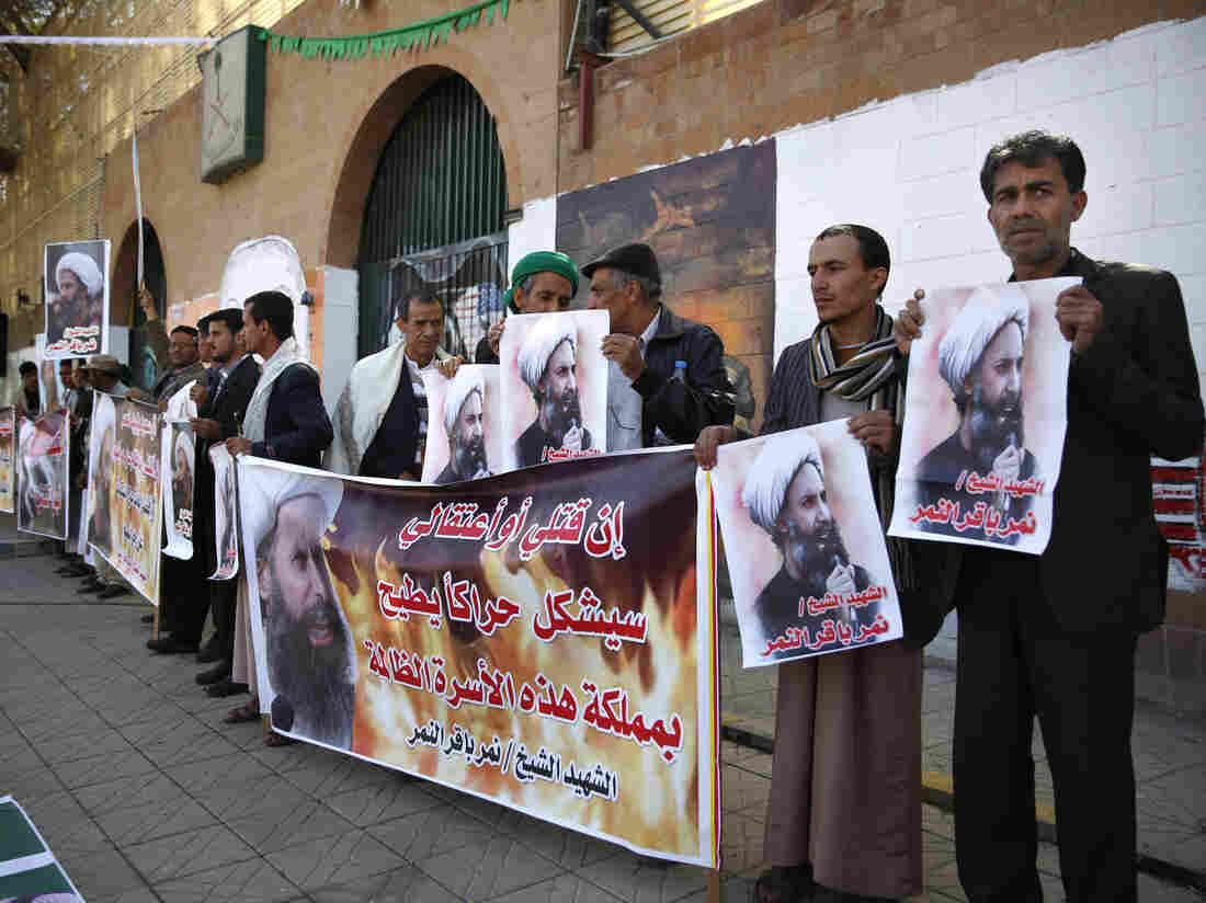 Shiite rebels hold posters of late Shiite cleric Nimr al-Nimr at a protest Thursday in Sanaa, Yemen. The cleric's execution by Saudi Arabia on Saturday sparked a dramatic deterioration in relations between Saudi and Iran.
