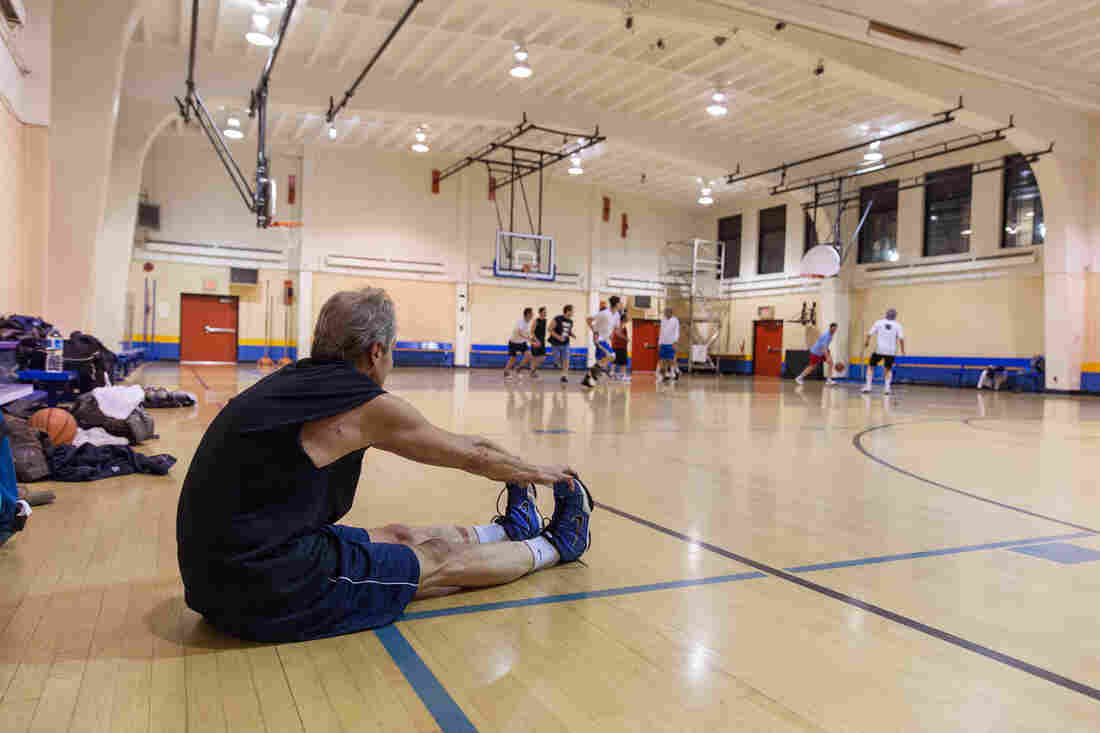 Peter Breslow stretches in between pickup basketball games at Jelleff Community Center in Washington, D.C. He's been playing the same weekly basketball game since 1982.