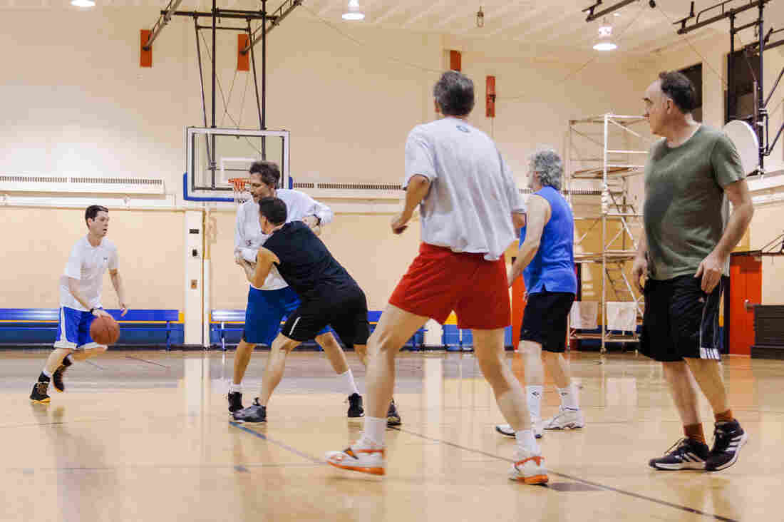 Ben Stutz (left) dribbles during a weekly pickup game at Jelleff Community Center in Washington, D.C., on Jan. 6. The players' ages span generations.
