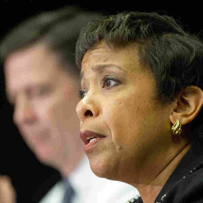 Attorney General Loretta Lynch (right) and FBI Director James Comey, seen at a meeting in Washington, D.C., in November,  are among the Obama administration officials meeting Friday with tech industry leaders.