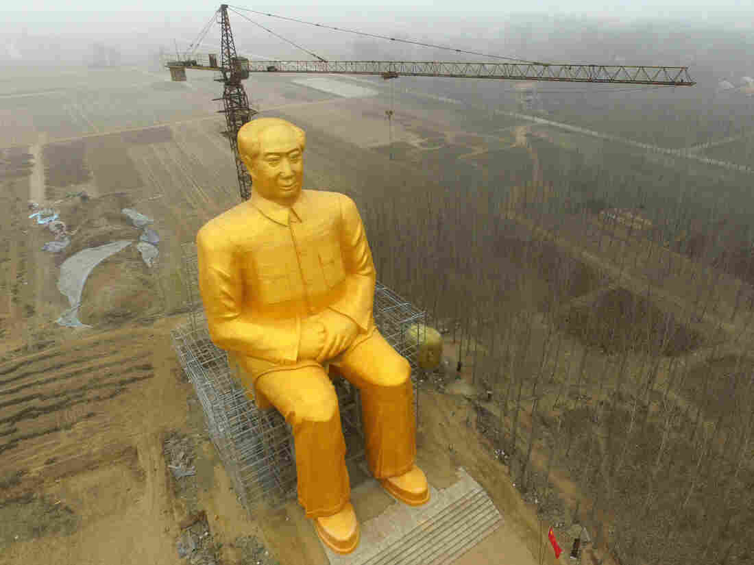 The huge statue of Chairman Mao Zedong in central China's Henan province before it was demolished.