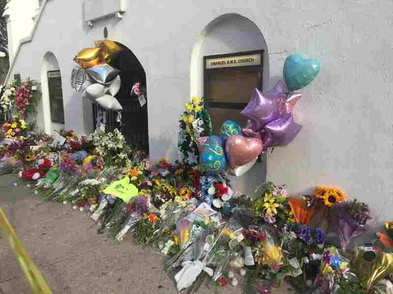 Community members placed flowers at the Emanuel AME Church in Charleston, S.C. after a gunman killed nine people there.