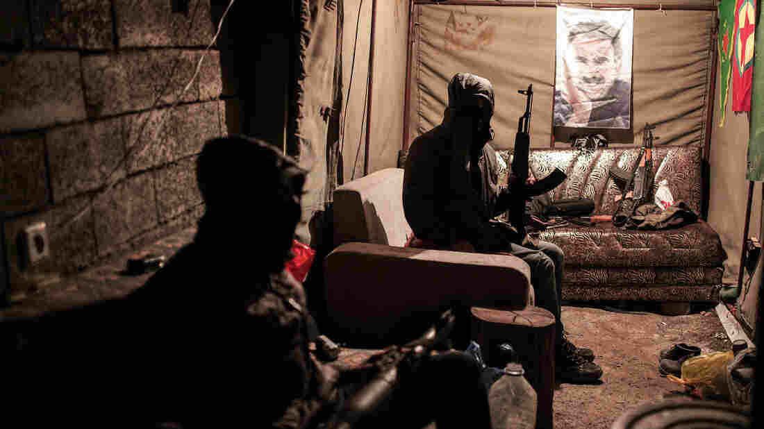 Militants of the Kurdistan Workers' Party, or PKK, in a bunker in Sirnak, Turkey, on Dec. 23. The militants and the Turkish military have been fighting regularly in southeast Turkey. A poster of jailed PKK leader Abdullah Ocalan is in the background.