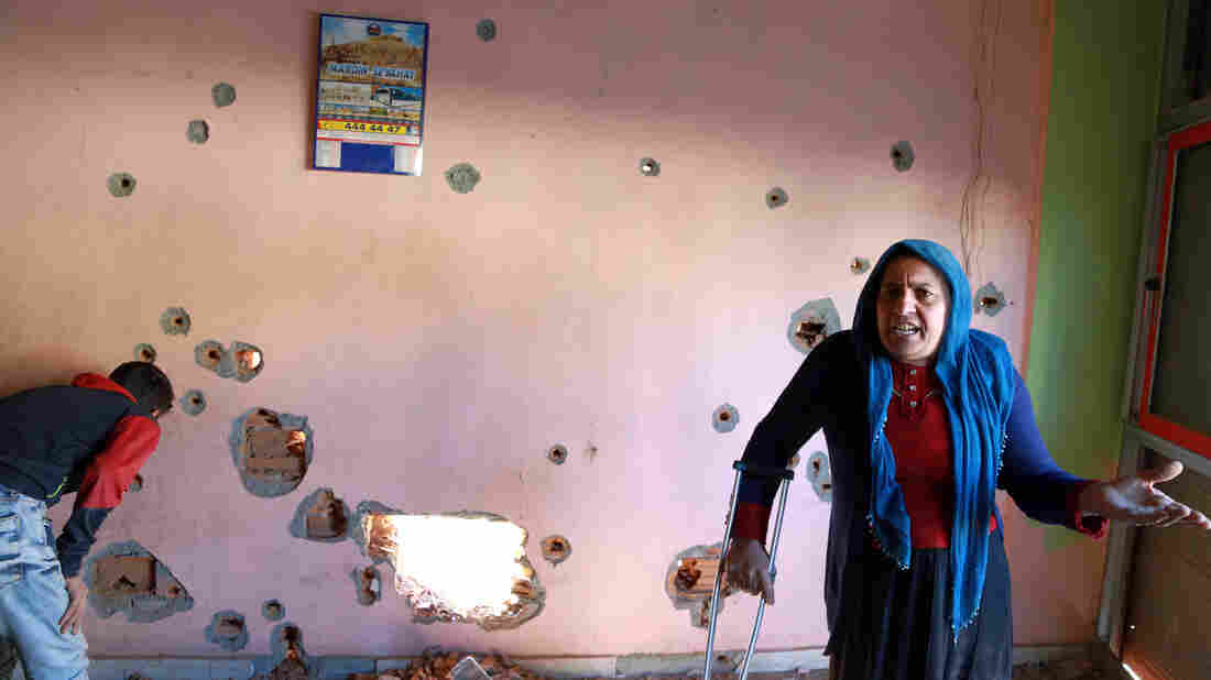 A woman complains inside her house in Nusaybin, Turkey, on Dec. 25. Tens of thousands of civilians in southeast Turkey have been caught in the middle as government forces and Kurdish militants battle.