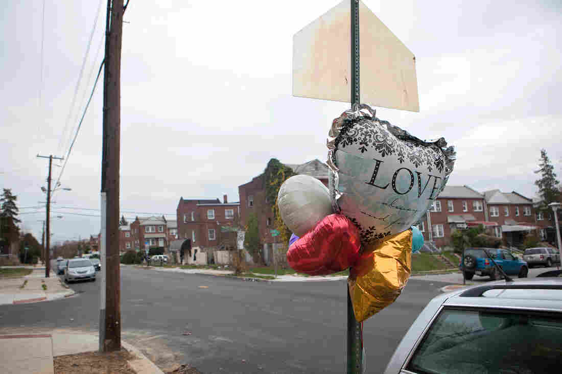 A memorial is seen on a West Baltimore street at the site of the city's 300th homicide on Nov. 19.