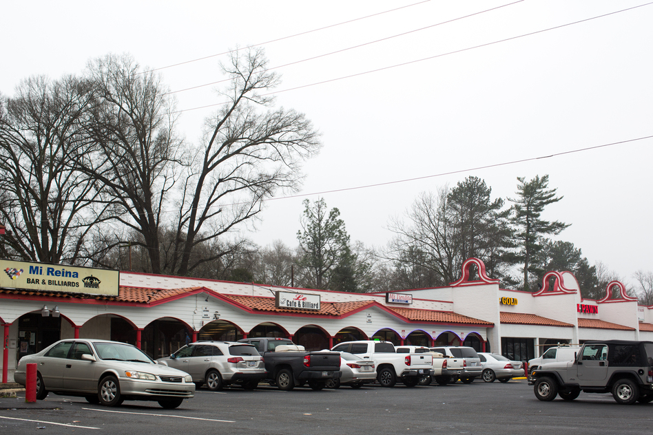 A strip mall sits just a block away from Central Avenue in East Charlotte, N.C. (Logan Cyrus for NPR)
