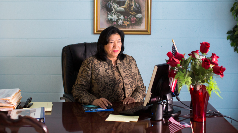 Maudia Melendez, minister at Jesus Ministry Inc., sits at her desk inside Statesville Road Baptist Church in Charlotte, N.C. (Logan Cyrus for NPR)
