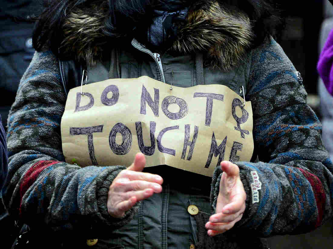 "A member of flash mob protesting the New Year's Eve sexual assaults in Cologne wears a sign reading, ""Do Not Touch Me."""
