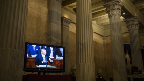 President Obama is seen on a television inside the U.S. Capitol delivering his last State of the Union address in 2015.