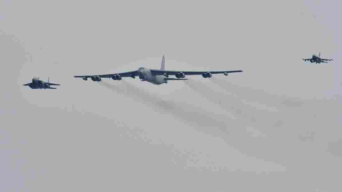 A US B-52 Stratofortress is escorted by a South Korean fighter jet (left) and a U.S. fighter jet (right) as it flies over the Osan Air Base in Pyeongtaek, south of Seoul, on Sunday.