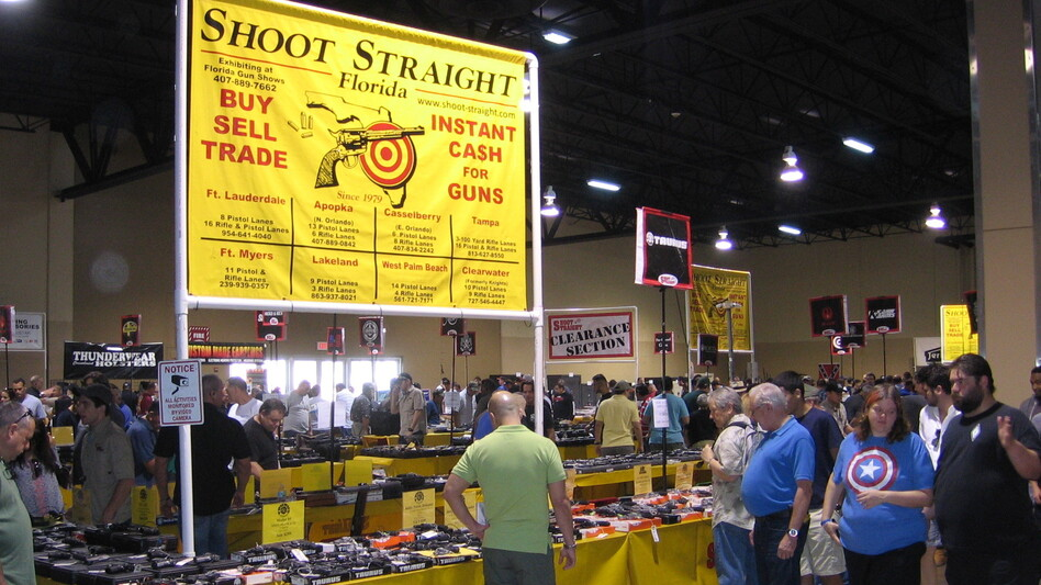 Attendees at a gun show in Miami have mixed feelings about Obama's executive actions. (Greg Allen/NPR)