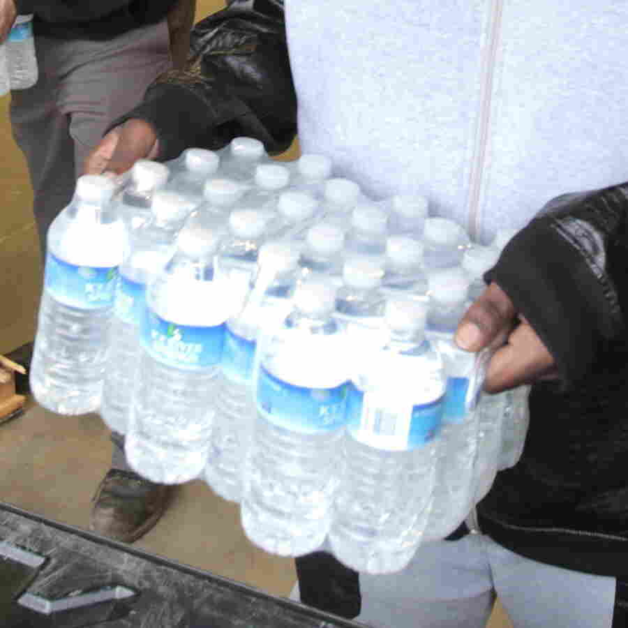 Anthony Fordham picks up bottled water to deliver to a school last month after elevated lead levels were found in the city's water in Flint, Mich.