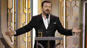 Host Ricky Gervais kept his drink close at hand during Sunday night's Golden Globes ceremony.