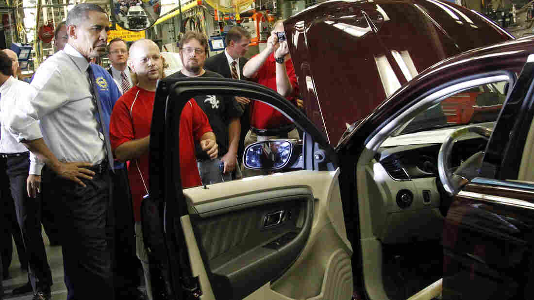 President Obama looks over a vehicle on the assembly line with autoworker Jeffrey Cook, during his tour of the Ford Motor Co. Chicago Assembly Plant in 2010.