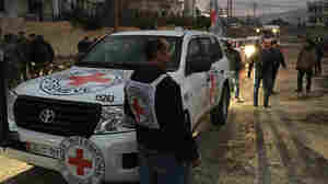 Trucks from the International Committee of the Red Cross, working alongside the Syrian Arab Red Crescent and the United Nations, carry food, medical items, blankets and other materials into the Syrian town of Madaya on Monday.