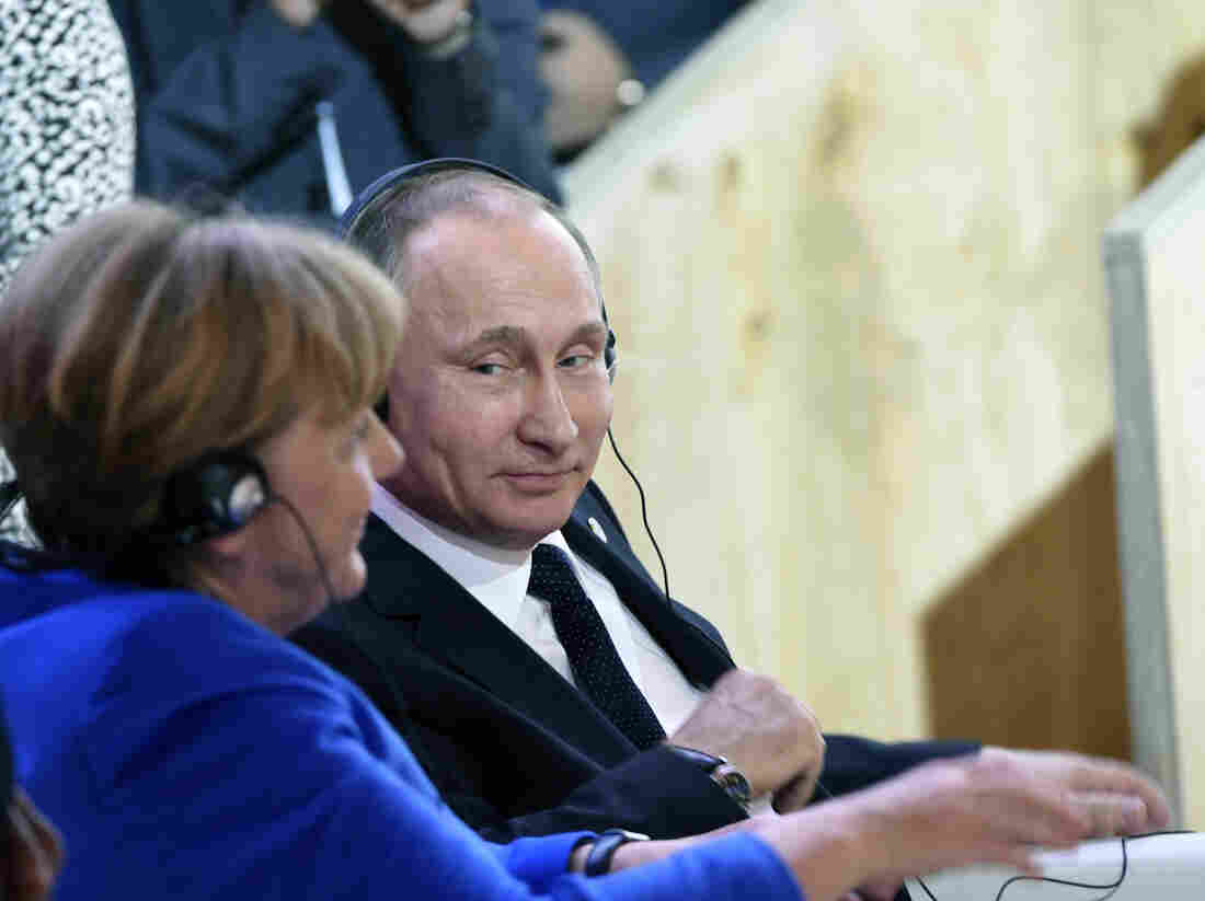 """""""I trust her, she is a very open person,"""" Vladimir Putin said of German Chancellor Angela Merkel, seen here at last month's climate talks in Paris. But, he told the German daily Bild, """"she is also subject to certain constraints and limitations."""""""
