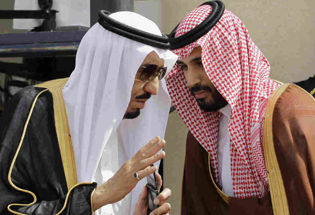 Saudi Arabia's King Salman (left) speaks with his son Mohammed in the capital Riyadh in 2012. The king was the crown prince at the time. When he assumed the throne last year, Salman named Mohammed, now 30, the deputy crown prince and defense minister. They have pursued a much more aggressive foreign policy in the region, particularly when it comes to confronting Iran.