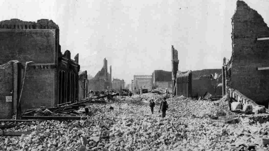 People walk through the rubble following the earthquake in San Francisco.