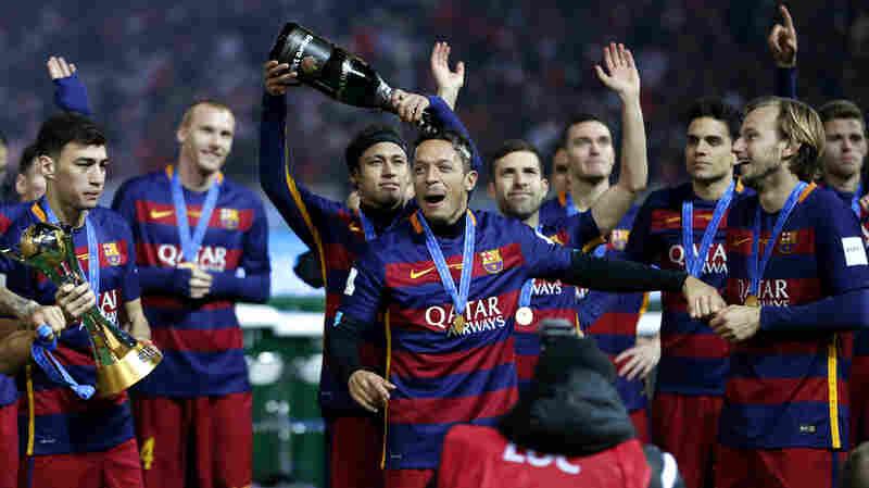 Futbol Club Barcelona's Neymar da Silva Santos pours champagne over Adriano as their team won the final match against River Plate at the FIFA Club World Cup soccer tournament in Yokohama, near Tokyo, on Dec. 20.