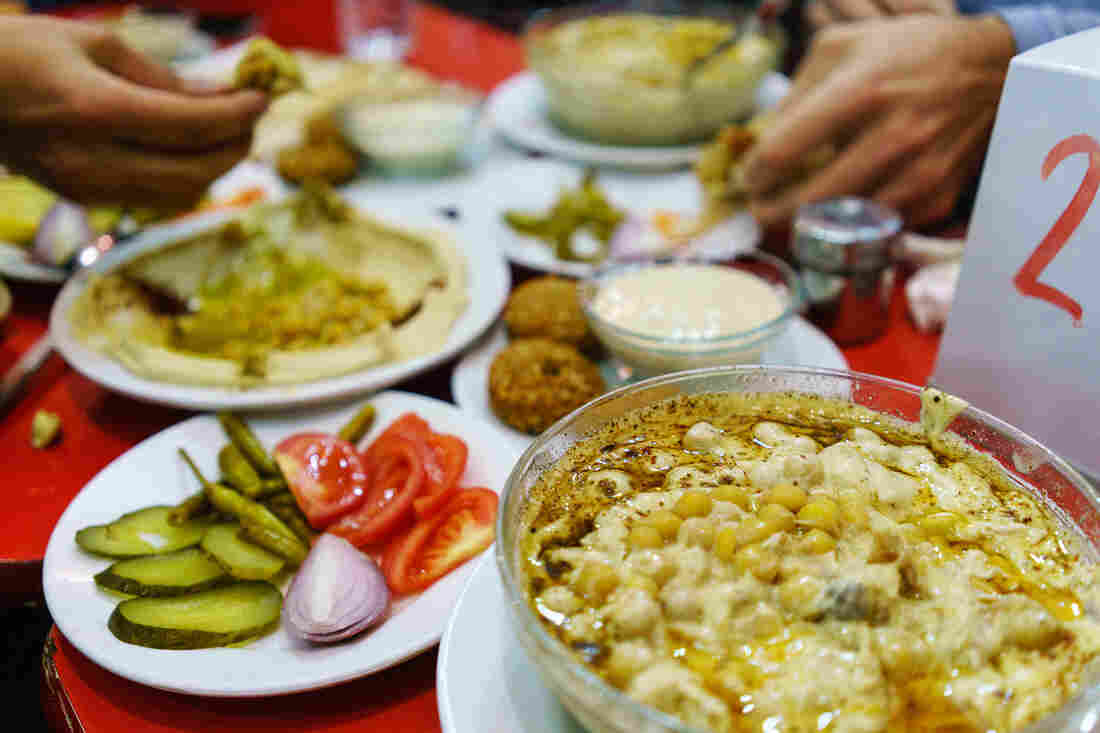 Plates piled with traditional Syrian food cover the table at Orijinal Halep Lokantasi, a restaurant in the southern Turkish city of Gaziantep.