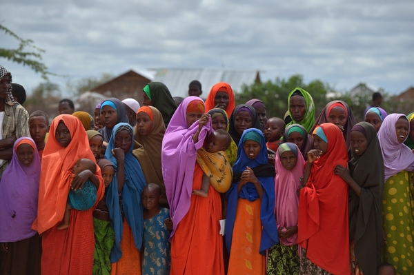 Somalis living in the Dadaab camp in Kenya gather to watch the arrival of the United Nations high commissioner for refugees last May.
