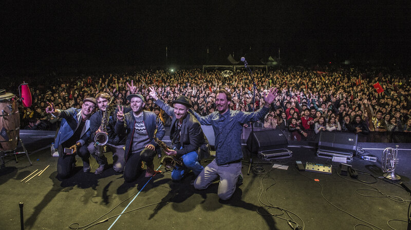 Danish Afrobeat-inspired band The KutiMangoes pose for photos with the crowd at the Jarasum International Jazz Festival.
