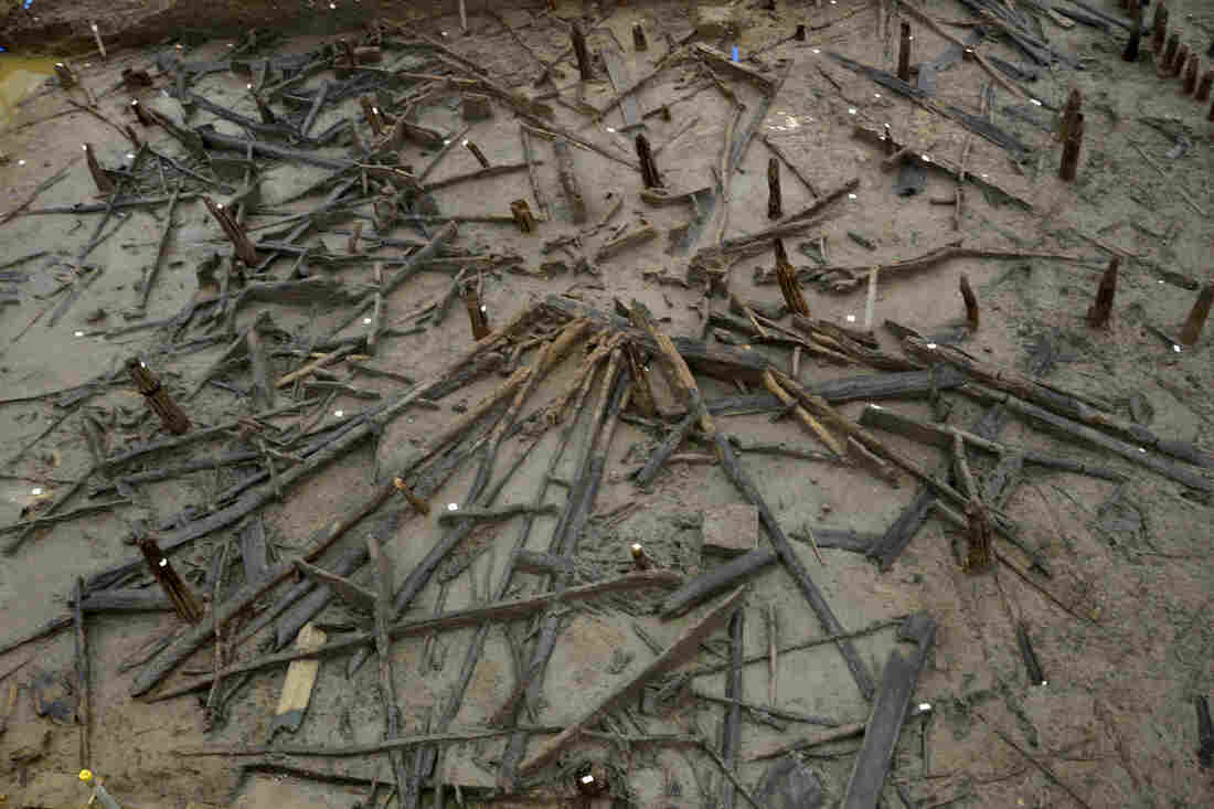 """Remains of a Bronze Age circular house show inner and outer post rings and collapsed roof timbers """"like spokes in a wheel."""""""