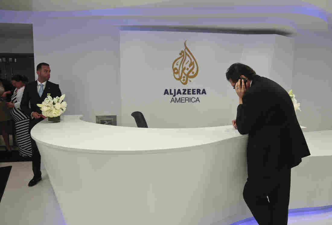 Visitors wait in the lobby of Al-Jazeera America after the network's first broadcast on Aug. 20, 2013, in New York. The network will shut down in April.