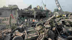 Rescuers search through the rubble of the U.S. Marine barracks Oct. 23, 1983, in Beirut, Lebanon, after a suicide truck bombing. The blast — the single deadliest attack on U.S. forces abroad since World War II — killed 241 American service members. The Supreme Court is deciding whether Congress can pass a law compensating the victims, and those of other attacks, using Iranian government funds.