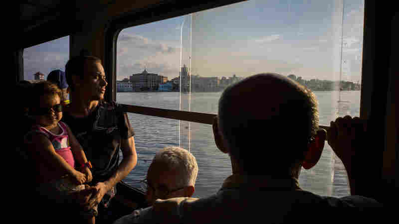 Passengers travel on one of the ferries that cut across Havana Bay from Casablanca to Old Havana in July 2015. While the Obama administration has approved licenses to companies that want to offer services to Miami, the plans are still controversial on both sides.