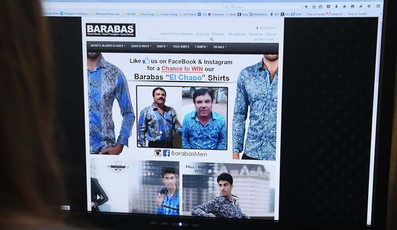 """A woman looks at the home page of the clothing house Barabas on Tuesday. At the time, the site featured two photos of Mexican drug kingpin Joaquin ""El"