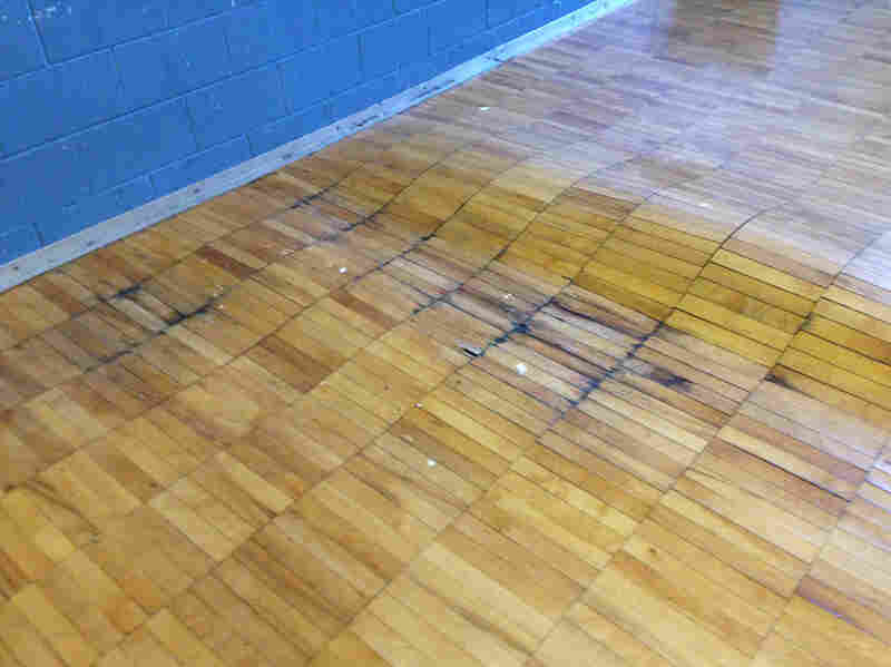 """Disrepair — such as this floor in the gym of Noble Elementary-Middle School in Detroit — and other problems have prompted the teachers' """"sickout"""" protests."""
