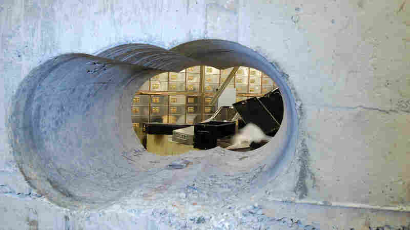 This image, supplied by the Metropolitan Police, shows a view of the hole drilled in the vault wall at Hatton Garden Safe Deposit Ltd. following the Easter weekend robbery last year in London. Millions of dollars worth of jewels, cash and other valuable items were taken. Seven men have now pleaded or been found guilty.