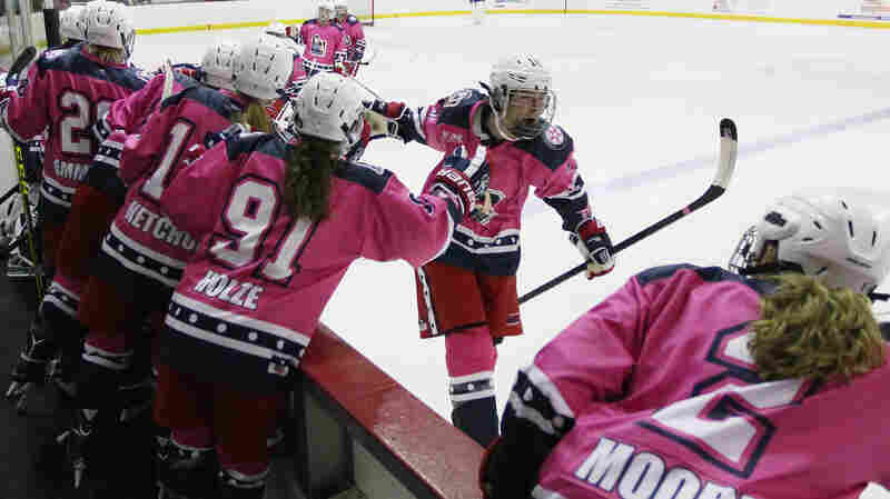 National Women's Hockey League player Ashley Johnston of the New York Riveters celebrates her goal with her teammates in a game against the Connecticut Whale in October. The game was part of a breast cancer awareness event, and the Riveters wore pink jerseys instead of their normal white.