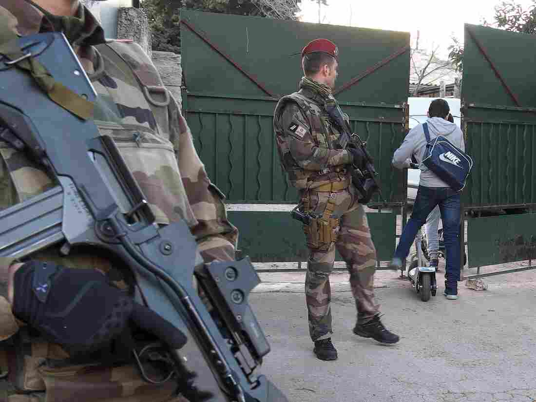 French soldiers guard access to a Jewish school in Marseille a day after a teenager wielding a butcher knife wounded a teacher.